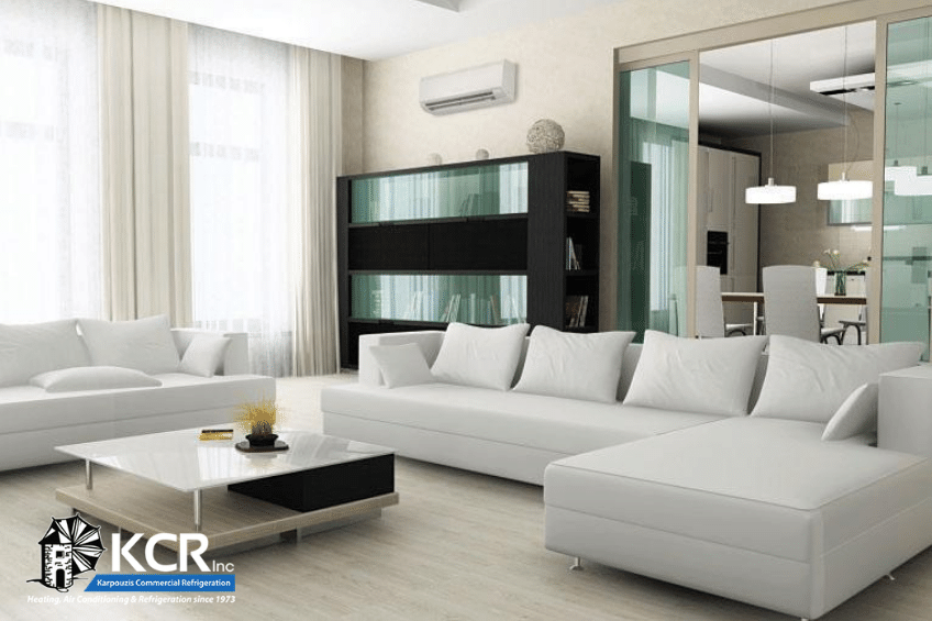 Mitsubishi ductless HVAC system in modern living room at home.
