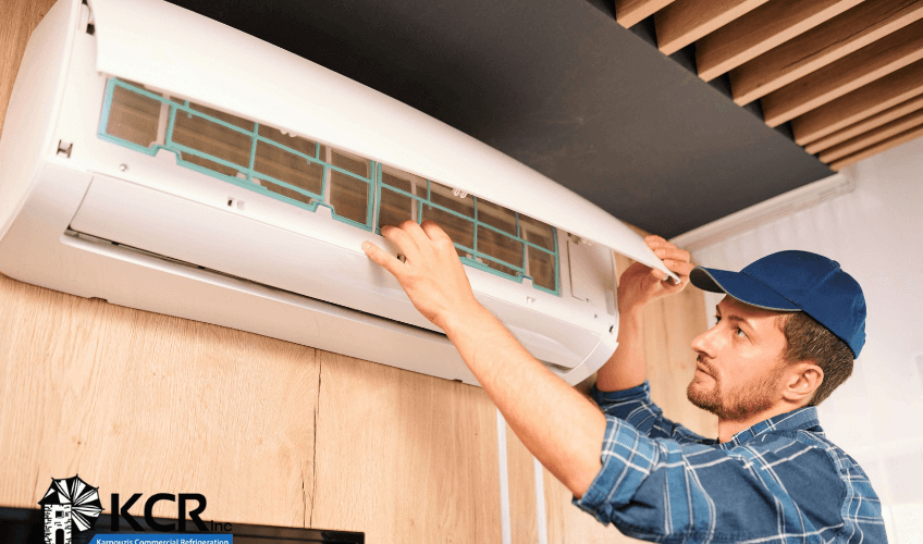 Technician Installing Residential HVAC Central Air Conditioner